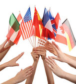 Hands holding different flags, isolated on white — Stock Photo