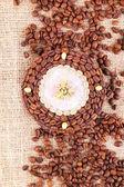 Beautiful clock of coffee beans, on burlap background — Stock Photo