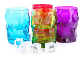 Colorful glasses and ice cubes isolated on white — Zdjęcie stockowe
