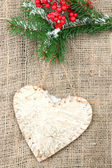Decorative heart on rope, on burlap background — Stock Photo