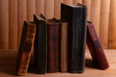 Old books on table on wooden background — ストック写真