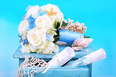 Beautiful wedding bouquet with roses on old table, on nature background — Stock Photo
