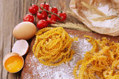 Still life with raw homemade pasta and ingredients for pasta — Stockfoto