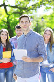 Happy students in park — Stockfoto