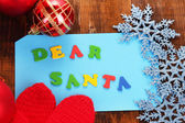 Letter to Santa Claus on wooden table close-up — Stockfoto