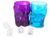 Colorful glasses and ice cubes isolated on white — Stock fotografie
