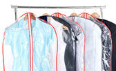 Office female clothes in cases for storing on hangers, isolated on white — Stock Photo