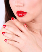Girl with red lips and nails, closeup — Stock Photo