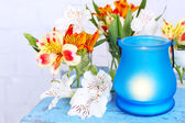 Bright icon-lamp with flowers on wooden stand on light background — Stock Photo