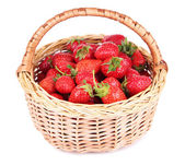 Ripe sweet strawberries in wicker basket, isolated on white — Stock Photo