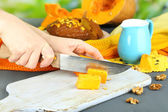 Cooking pumpkin pie on wooden table on natural background — Stock Photo