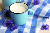 Cups of milk and cornflowers on wooden table — Stock Photo