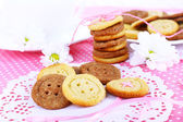 Sugar cookies in shape of buttons on table — Stock Photo