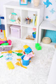 Colorful toys on fluffy carpet in children room — Stok fotoğraf