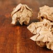 Crumpled paper balls on wooden background — Stock Photo #47988865