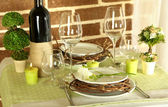 Beautiful holiday Easter table setting in green tones, on bright background — Stock Photo