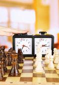 Hand pushing chess clock, close up — Stock Photo