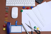 Office table with stationery accessories, keyboard and paper, close up — ストック写真