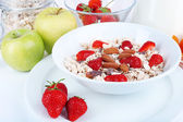 Healthy cereal with milk and fruits close up — Stock fotografie