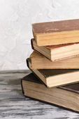 Old books on table on grey background — Stock Photo
