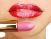 Beautiful female lips with lipstick, close up — Stock Photo