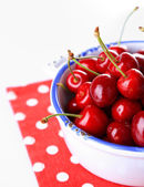 Sweet cherry on color plate isolated on white — 图库照片