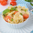 Delicious pasta with tomatoes on plate on table close-up — Stock Photo #48028369