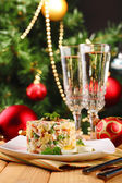 Russian traditional salad Olivier, on color napkin, on wooden  table, on bright background — Stock Photo