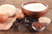 Ingredients for making cookies on wooden background — Stock Photo