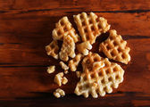 Crushed waffle on wooden background — Stock fotografie