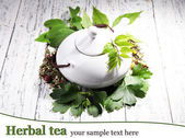 Herbal natural tea with dry flowers and herbs ingredients, on color wooden background — Stock Photo