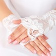 Wedding gloves on hands of bride, close-up — Stock Photo