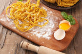 Still life with raw homemade pasta and ingredients for pasta — Foto de Stock