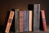 Old books on table on brown background  — Stok fotoğraf