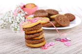 Sugar cookies in shape of buttons on table — Foto de Stock