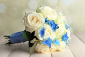 Beautiful wedding bouquet with roses on wooden table — Stock Photo