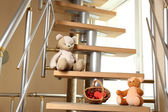 Teddy bears on home stairs — Foto Stock