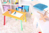 Modern playroom for children with bright table — 图库照片