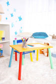 Modern playroom for children with bright table — Stok fotoğraf