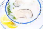 Tasty soup with oysters, isolated on white — Foto de Stock