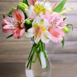 Alstroemeria flowers in vase on table on grey background — Stock Photo #48094163
