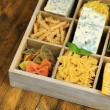 Italian products in wooden box on table close-up — Zdjęcie stockowe #48094729