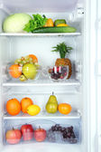Vegetables and fruits in open refrigerator. Weight loss diet concept. — 图库照片