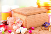 Handmade wooden box and art materials for decor, on table — Stock Photo