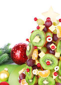 Fruit Christmas tree on table on white background — 图库照片