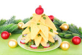 Christmas tree from cheese on table on white background — Zdjęcie stockowe