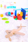 Paper airplane toy in room on the carpet — Stock Photo