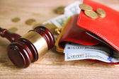 Gavel and money coins on wooden background — Stock Photo