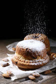 Tasty cakes on table on black background — 图库照片