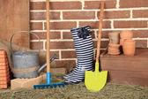 Tools of gardener on  bricks background — Stock Photo